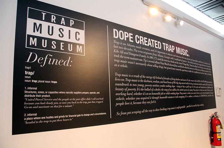 A large sign explains the meaning and history of trap music in T.I.'s Trap Music Museum