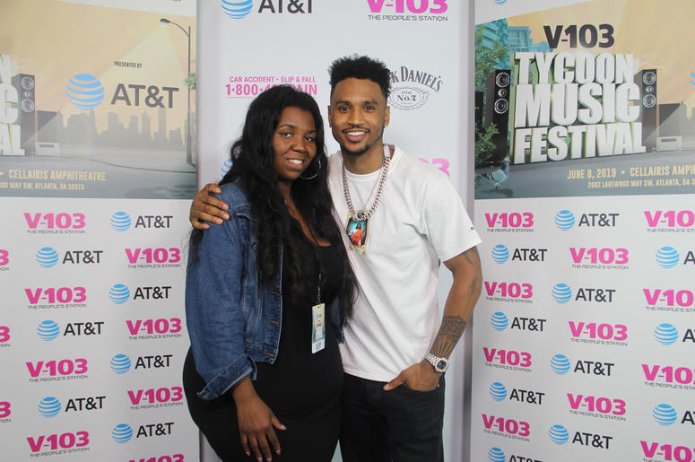 Trey Songz takes a photo with fans