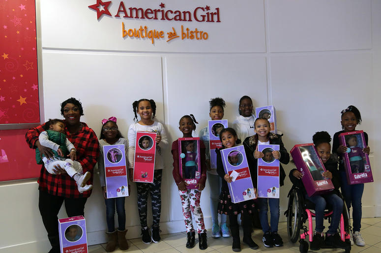 Girls receive American Girl dolls from V-103's Frank and Wanda In The Morning