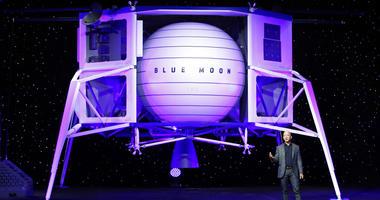 Jeff Bezos speaks in front of a model of Blue Origin's Blue Moon