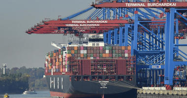 container ship is loaded at the harbor in Hamburg, Germany