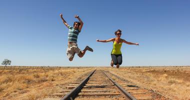 people on train tracks