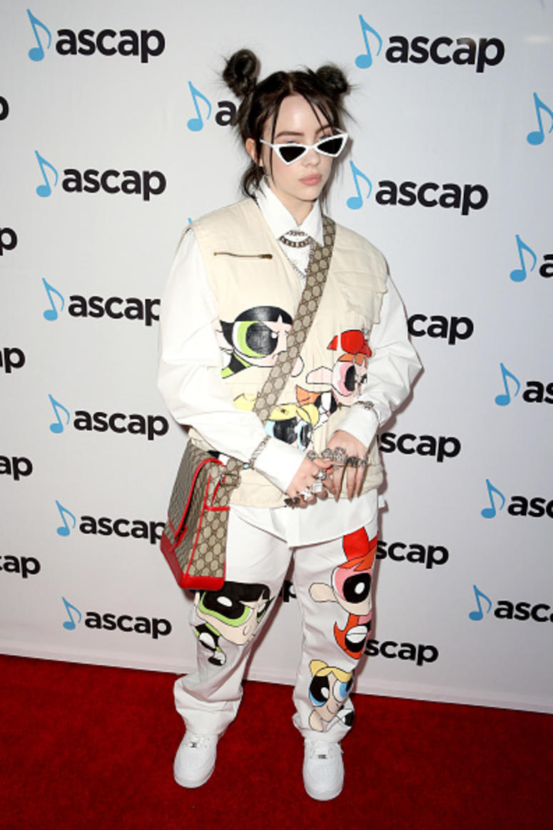 Billie Eilish gets photographed at an awards show.