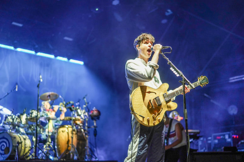 Ezra Koenig of Vampire Weekend performing live in 2018
