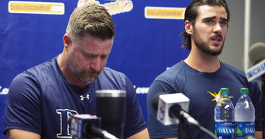 Montgomery Biscuits manager Morgan Ensberg, left, fights back tears as Ryan Thompson