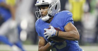 Nov 23, 2017; Detroit, MI, USA; Detroit Lions wide receiver Golden Tate (15) runs with the ball during the third quarter against the Minnesota Vikings at Ford Field.