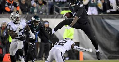 Dec 25, 2017; Philadelphia, PA, USA; Philadelphia Eagles running back LeGarrette Blount (29) leaps over Oakland Raiders strong safety Karl Joseph (42) during an NFL football game at Lincoln Financial Field.