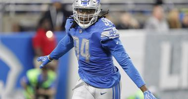 Dec 31, 2017; Detroit, MI, USA; Detroit Lions defensive end Ezekiel Ansah (94) celebrates after a play during the second quarter against the Green Bay Packers at Ford Field.