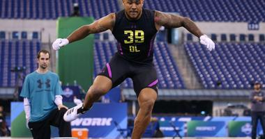 Mar 4, 2018; Indianapolis, IN, USA; Boston College Eagles defensive lineman Harold Landry goes through work out drills during the 2018 NFL Combine at Lucas Oil Stadium.