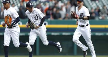 Apr 21, 2018; Detroit, MI, USA; Detroit Tigers right fielder Nicholas Castellanos (right) and center fielder JaCoby Jones (21) share a laugh after the game against the Kansas City Royals at Comerica Park.