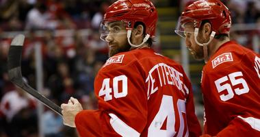 Feb 15, 2017; Detroit, MI, USA; Detroit Red Wings left wing Henrik Zetterberg (40) and defenseman Niklas Kronwall (55) display a patch on their sweaters for owner Mike Ilitch in the third period against the St. Louis Blues at Joe Louis Arena.