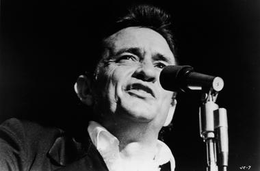 Johnny Cash (1932 - 2003) singing on stage in a still from the film, 'Johnny Cash - The Man, His World, His Music,' directed by Robert Elfstrom, 1969.