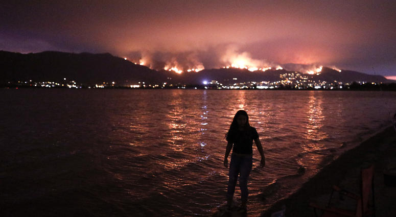 14,000 fight California fires, some from prisons or overseas | 106 3