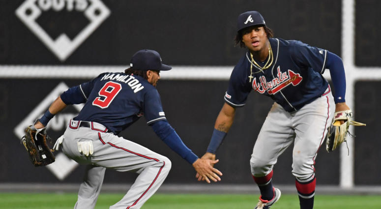 Atlanta Braves Outfielders Billy Hamilton (left) and Ronald Acuna Jr. (right)
