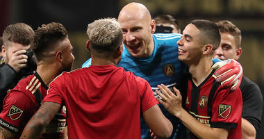 Atlanta United forward Hector Villalba, forward Josef Martinez, goalkeeper Brad Guzan, and midfielder Miguel Almiron react after defeating the New York Red Bulls