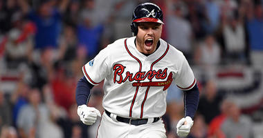 Atlanta Braves first baseman Freddie Freeman reacts after hitting a solo home run