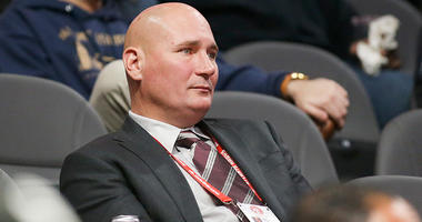 Atlanta Hawks general manager Travis Schlenk watches a game against the Washington Wizards