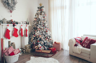Beautiful holdiay decorated room with Christmas tree with presents under it